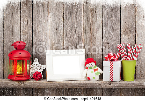 Christmas candle lantern, photo frame and decor - csp41491648