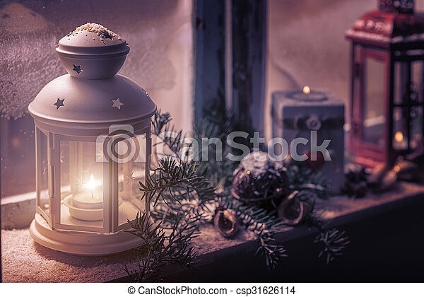 Christmas - candles glow in the steamy window - csp31626114