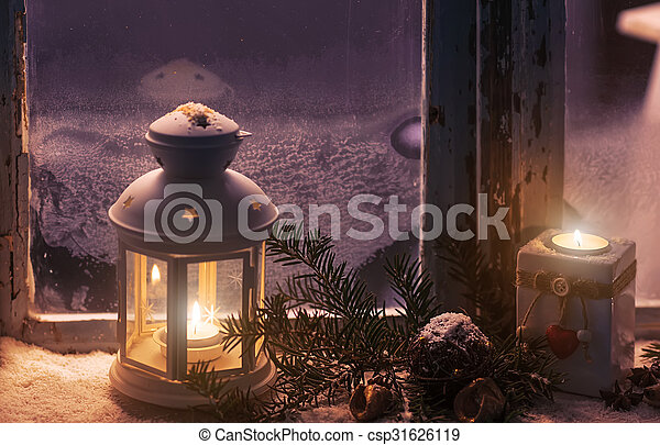 Christmas - candles glow in the steamy window - csp31626119