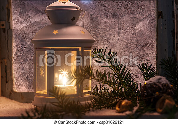 Christmas - candles glow in the steamy window - csp31626121