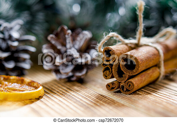 Christmas card: Cinnamon and slices of orange for Christmas - csp72672070
