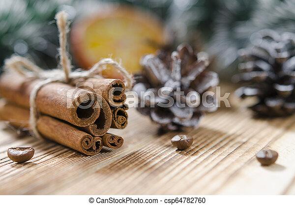 Christmas card: Cinnamon and slices of orange for Christmas - csp64782760