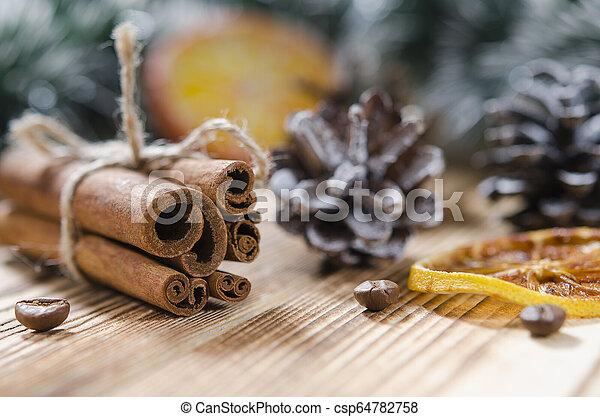 Christmas card: Cinnamon and slices of orange for Christmas - csp64782758