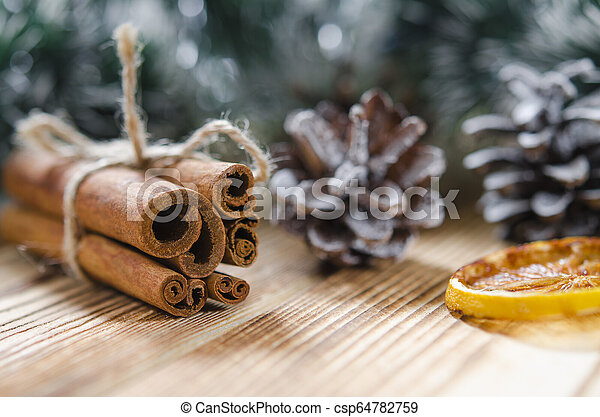 Christmas card: Cinnamon and slices of orange for Christmas - csp64782759