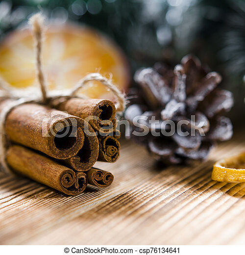 Christmas card: Cinnamon and slices of orange for Christmas - csp76134641