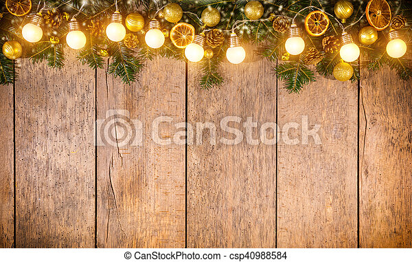 christmas colored lights with decoration on wood csp40988584