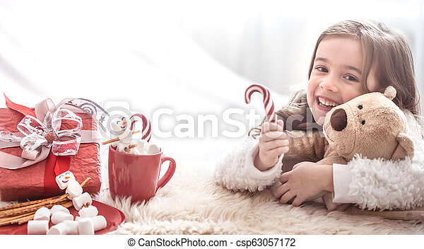 Christmas concept little girl hugging bear toy - csp63057172