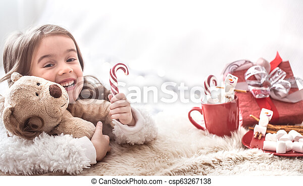 Christmas concept little girl hugging bear toy - csp63267138