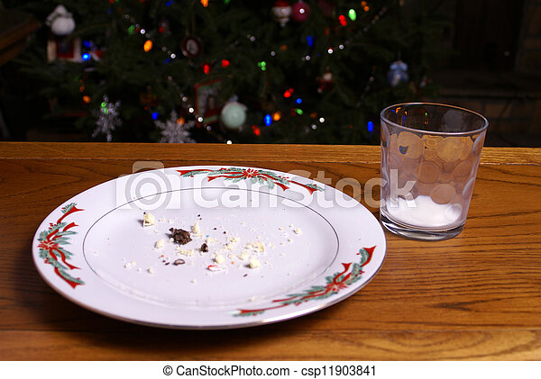 Christmas Cookie Crumbs and Empty Milk Glass - csp11903841