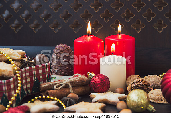 Christmas cookies with candles - csp41997515