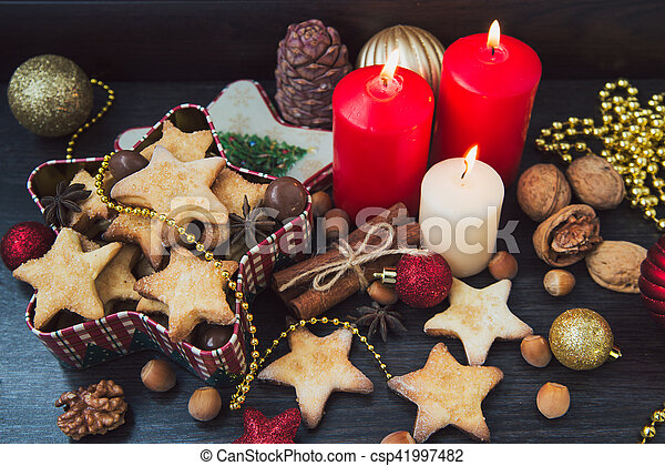 Christmas cookies with candles - csp41997482