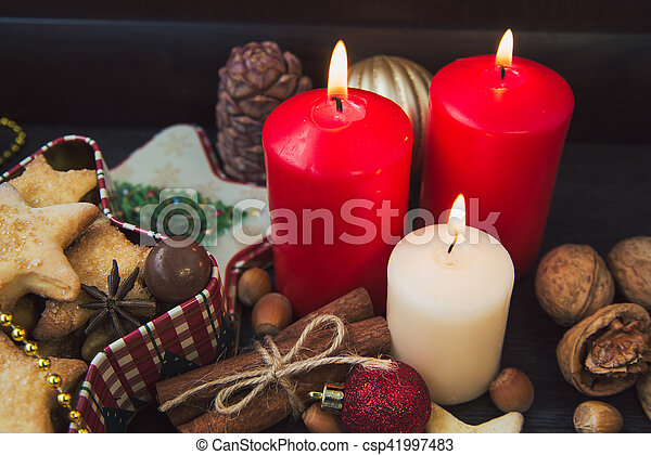 Christmas cookies with candles - csp41997483