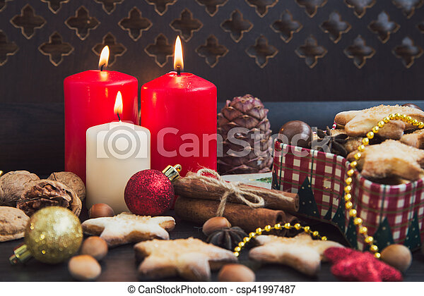 Christmas cookies with candles - csp41997487