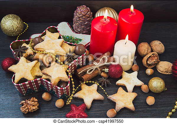 Christmas cookies with candles - csp41997550