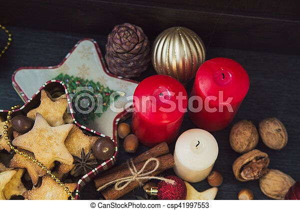 Christmas cookies with candles - csp41997553