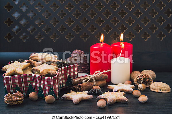 Christmas cookies with candles - csp41997524