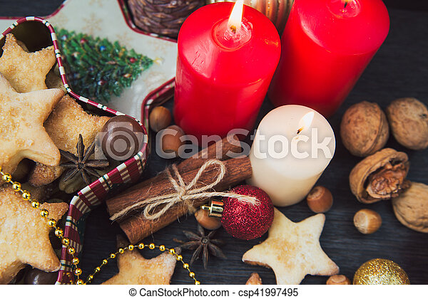 Christmas cookies with candles - csp41997495