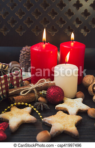 Christmas cookies with candles - csp41997496