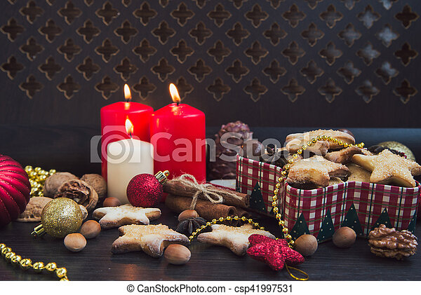 Christmas cookies with candles - csp41997531