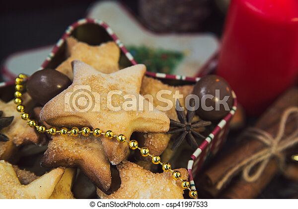 Christmas cookies with candles - csp41997533