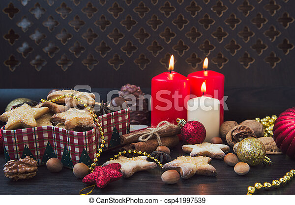 Christmas cookies with candles - csp41997539