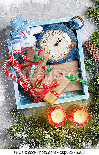 Christmas decor, gifts, candles and fir tree