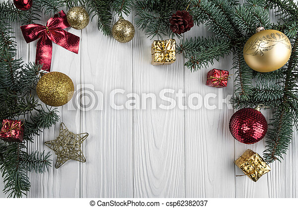 Christmas decoration frame on white wooden background - csp62382037