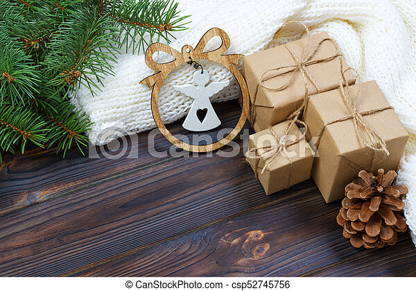 Christmas decoration, gift boxes and angel figure frame background, top  view with copy space on white wood table surface. Christmas ornaments and