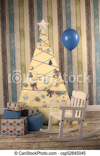 Strange Christmas Decoration Interior With Tree Presents And Baby Rocking Chair Machost Co Dining Chair Design Ideas Machostcouk