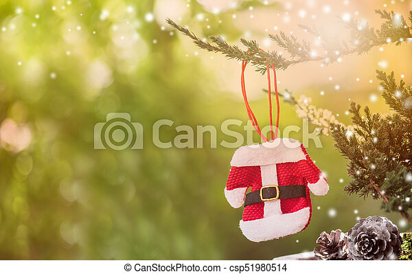 Christmas decoration on the tree with snow in winter - csp51980514