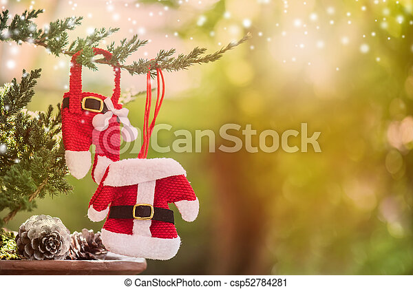 Christmas decoration on the tree with snow in winter - csp52784281
