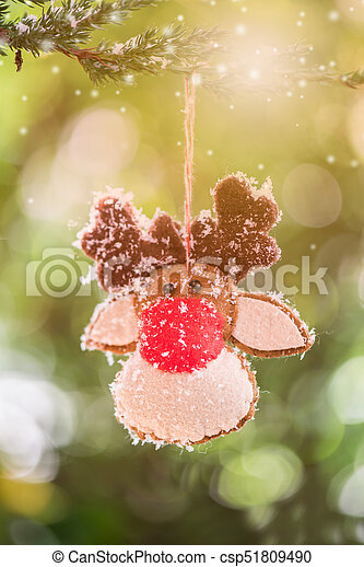 Christmas decoration on the tree with snow in winter - csp51809490