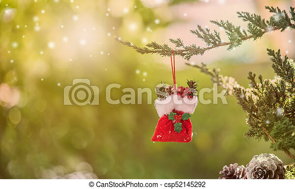 Christmas decoration on the tree with snow in winter - csp52145292