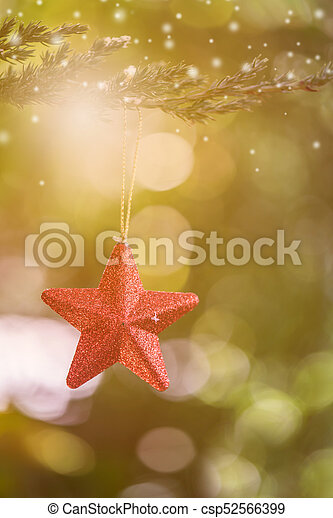Christmas decoration on the tree with snow in winter - csp52566399