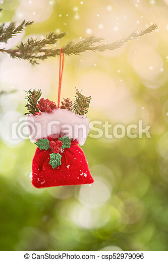 Christmas decoration on the tree with snow in winter - csp52979096