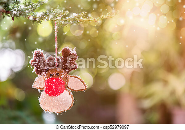 Christmas decoration on the tree with snow in winter - csp52979097