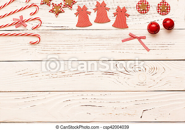 Christmas decoration on wooden background - csp42004039