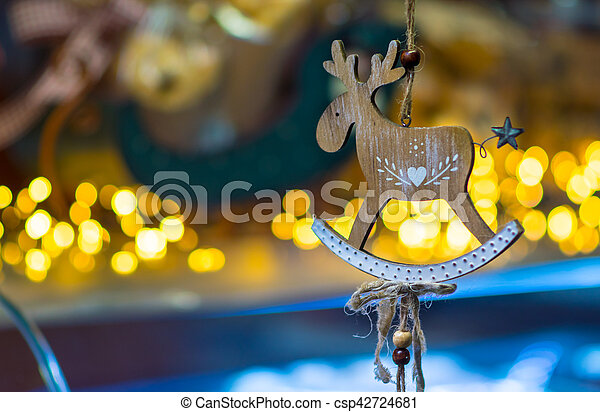 christmas decoration with a wooden deer hanging on a thread csp42724681 - Wooden Deer Christmas Decorations