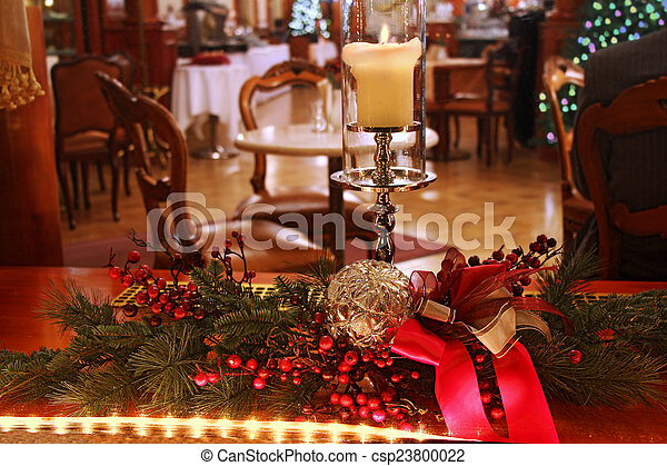 Christmas decoration with burning candle - csp23800022
