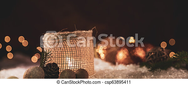 Christmas decorations. Candle with golden spheres - csp63895411