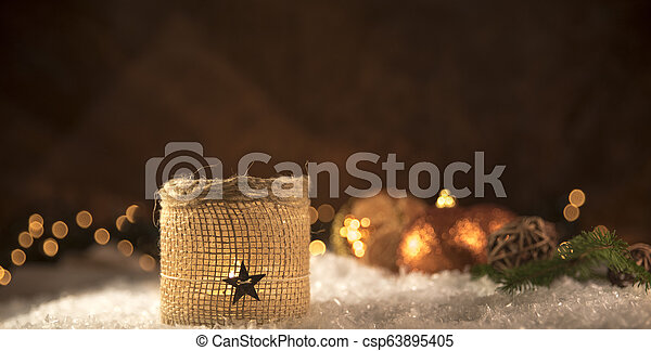 Christmas decorations. Candle with golden spheres - csp63895405