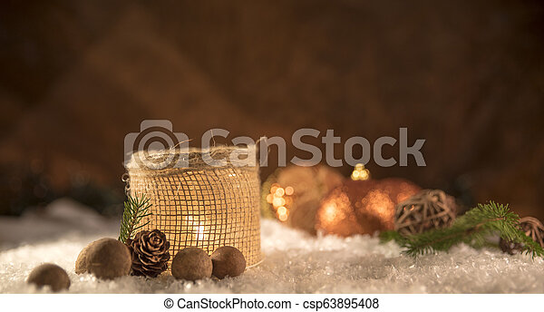 Christmas decorations. Candle with golden spheres - csp63895408