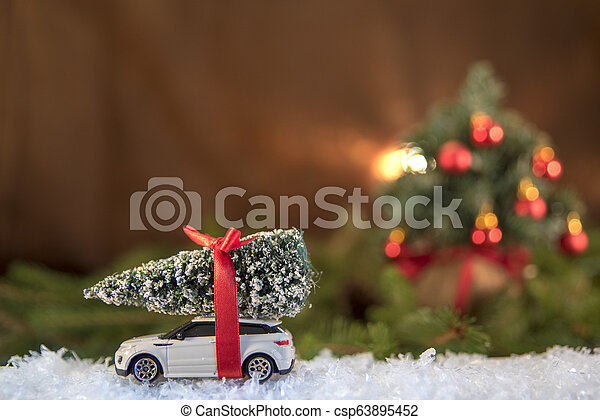 Christmas decorations. Christmas tree over toy car - csp63895452