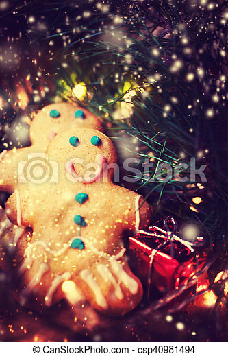 christmas decorations gingerbread man cookie over dark festive background