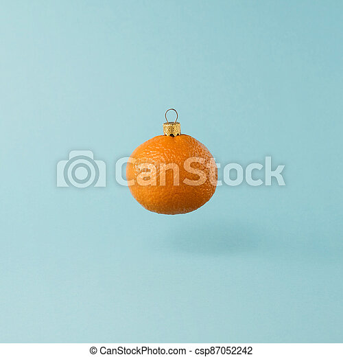 Christmas decorations made from orange tangerine fruit. Minimal New Years concept. - csp87052242