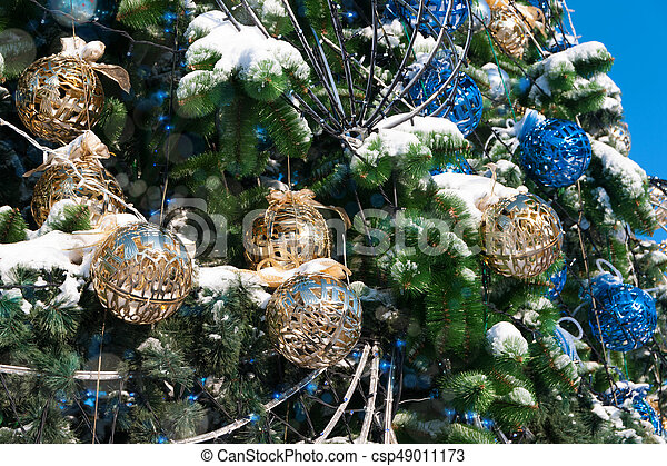 Christmas Decorations On A Street Tree In Winter