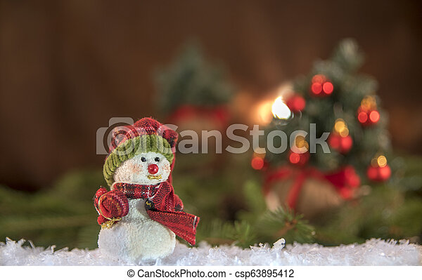 Christmas decorations. Snowman with Christmas tree in the background - csp63895412