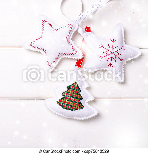 Christmas decorations with stars and tree on white wooden background. Xmas and Happy New Year composition. Square. - csp75848529