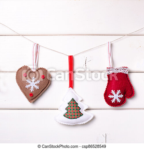 Christmas decorations with stars and tree on white wooden background. Xmas and Happy New Year composition - csp86528549