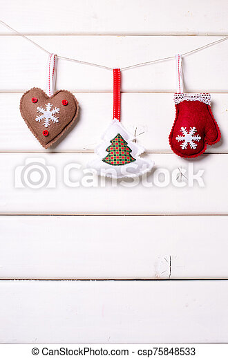 Christmas decorations with stars and tree on white wooden background. Xmas and Happy New Year composition. Vertical. - csp75848533